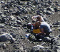 researchers working with volcanic rocks