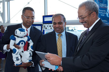 Photo of Andrew Williams with SpelBot robot, Congressman Fattah and NSF Director Subra Suresh.