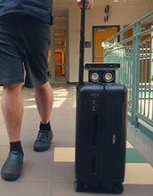 a smart suitcase that warns blind users of impending collisions