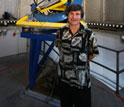 Photo showing Alex Filippenko in front of the Katzman Automatic Imaging Telescope.