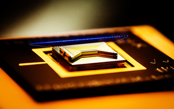 A fabricated trap that researchers use to capture and control atomic ion qubits (quantum bits).