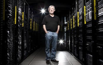 Man standing in front of large computers