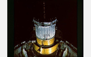 Photo of the TDRS during its deployment by the crew of the space shuttle Challenger in 1983.