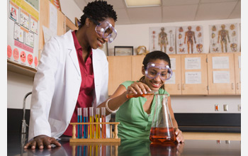 Photo of a teacher and student in a science lab.