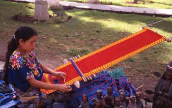 Photo of woman from Guatemala making a textile.