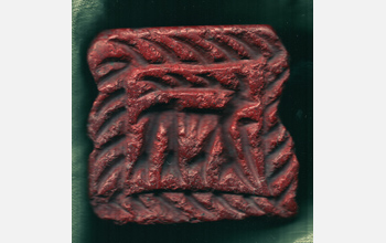 Photo of a red stone seal with an image of a deer.