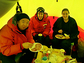 Three researchers share a meal in an Antarctic tent