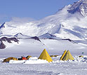 A group of Scott tents pitched in the shadow of the Transantarctic Mountains.