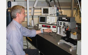 Photo of William Stillman in the lab evaluating the effects of focused terahertz radiation.