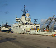 The research vessels Thompson and Langseth in port at the Guam Naval Base before the cruise began.