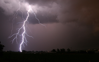 A cloud-to-ground lightning strike during a nighttime thunderstorm in the U.S. Midwest.
