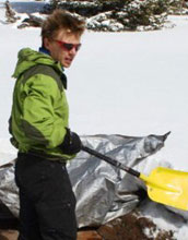 Scientist Adrian Harpold digs out an instrument used to measure snowmelt chemistry.