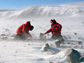 Photo of John Goodge and a colleague collecting specimens in the Transantarctic Mountains.