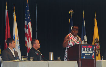 Photo of Kara Hayes, Wounded Warrior, presenting a Transition Success Story.