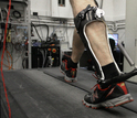 man walking on treadmill with a passive-elastic ankle exoskeleton attached