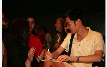 Photo of Terry Tao signing autographs for students at Thomas Jefferson High School, Arlington, Va.