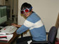 Photo of Raul Cal modeling the cool laser eye-protecting glasses used during the experiments.