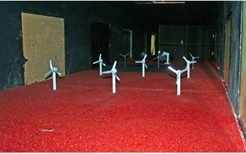 Photo showing model windmills in the tunnel that replicate the arrangement in a typical wind farm.