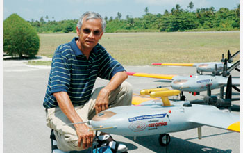 Photo of V. Ramanathan with several autonomous unmanned aerial vehicles.