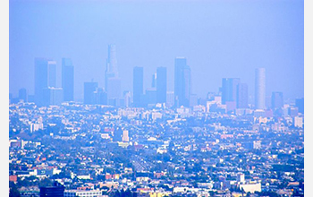 Photo showing haze and smoke covering the skyline of Los Angeles, California.