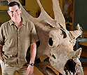 Photo of Scott Sampson with the skull of Utahceratops gettyi.