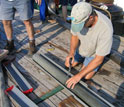 Photo of WHOI scientist Alan Gagnon preparing core samples.