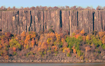 View of Palisade Sill near Alpine, N.J., from across a river.