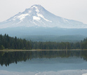 Mount Hood mirrored in a placid lake below