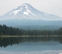 Mount Hood mirrored in a placid lake below