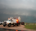 Doppler-on-Wheels and cars with a tornado in the background