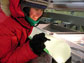 A scientist examines an ice core in West Antarctica