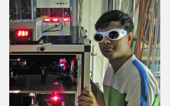 Photo of Apratim Dhar at the FReI instrument.