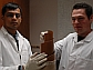 Researchers hold the polymer that is critical to their water filtration system.
