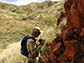Benjamin Johnson woks at an outcrop in remote Western Australia