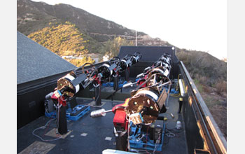 Photo of the MEarth telescopes at Mt. Hopkins, Arizona.