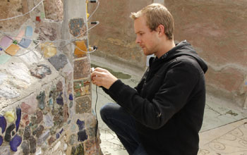 Graduate Student Jackson English installing crack displacement sensors on the Watts Towers