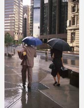 People holding umbrellas in rainy weather.