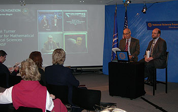 Participants at the live webcast in the studio and on screen.