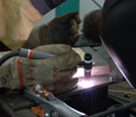 A person learning to weld.