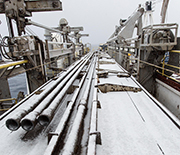 Snow-covered drilling equipment on a previous ocean drilling expedition to the Antarctic�s Ross Sea.