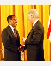 William Julius Wilson receives the Medal of Science from President Clinton.
