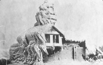 Historic photo of  a house covered in ice and snow following a snowstorm in Oswego, N.Y.;