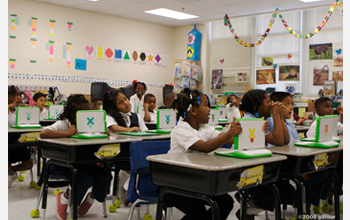 Photo of students using XO laptops.
