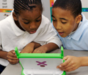 Photo of two boys working together on a Memorize activity in a fifth-grade class.