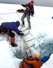 Three scientist perform a crevasse search-and-rescue drill
