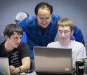 professor Yunsheng Wang working with two students.