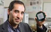 Masoud Agah is holding up a microelectrode array