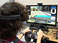a teenager using the driving simulator