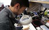 Baris Ozbay examines the laser-scanning microscope