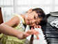 a little girl at a piano